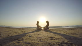 Girlfriends making breath exercises on the shore stock footage