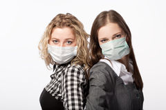 Girlfriends in medical masks Stock Image