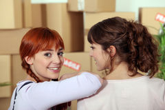 Girlfriends moving into an apartment Stock Photo