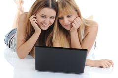 Girlfriends with a notebook Royalty Free Stock Photo