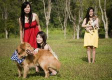 Girlfriends outdoor in the park with pet dogs Royalty Free Stock Photo