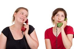 Girlfriends on the phone Royalty Free Stock Image