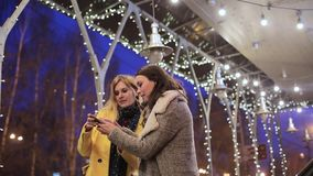 Girlfriends photographed on the background of night city. Outdoors stock footage