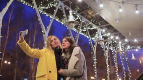 Girlfriends photographed on the background of night city. Outdoors stock video footage