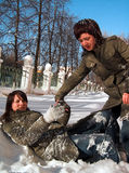 Girlfriends play. Girlfriends struggle in a snow Royalty Free Stock Image