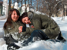 Girlfriends play. Girlfriends struggle in a snow Royalty Free Stock Photos