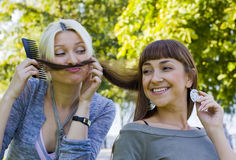 Girlfriends play Stock Image