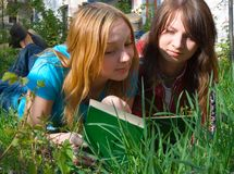 The girlfriends read the book. Stock Image