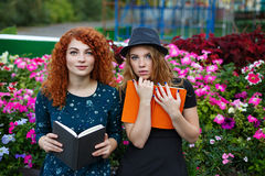 Girlfriends read book in the park. Stock Photography