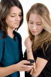 Girlfriends read an email. Or sms Royalty Free Stock Images