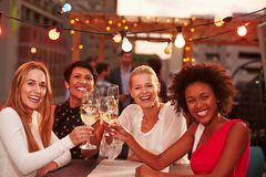 Girlfriends at rooftop party Stock Photography