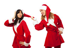 Girlfriends in santa costume Royalty Free Stock Image