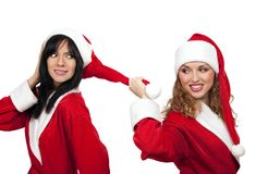 Girlfriends in santa costume Stock Images
