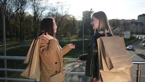 Girlfriends sharing impressions after shopping stock footage
