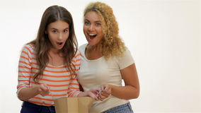 Girlfriends shopaholics look in the package stock footage