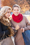 Girlfriends with shopping in the city Stock Images
