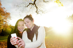 Girlfriends with smartphone Stock Photo