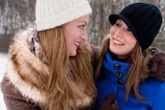 Girlfriends smiling at eachother Royalty Free Stock Image