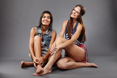 Girlfriends smiling and having fun Royalty Free Stock Images
