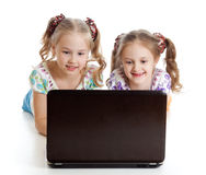 Girlfriends smiling and looking at the laptop Stock Photo