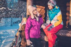 Girlfriends spending winter holiday on mountain cottage. Royalty Free Stock Photos