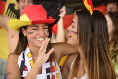 Girlfriends sport soccer fans celebrating. Stock Photo