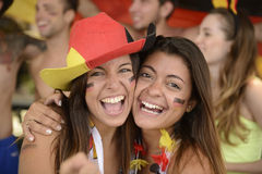 Girlfriends sport soccer fans celebrating. stock photos