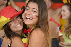Girlfriends sport soccer fans celebrating. Stock Images