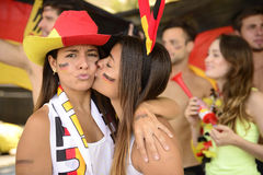 Girlfriends sport soccer fans celebrating. Royalty Free Stock Photo