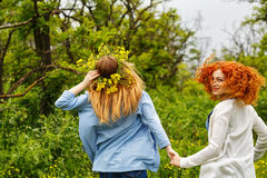Girlfriends strolling hand in hand. Royalty Free Stock Photos