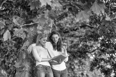 Girlfriends student. Two young girls read book royalty free stock photos