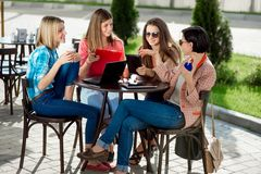 Girlfriends studying and heaving fun Stock Image