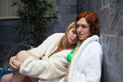 Girlfriends in swimming pool Royalty Free Stock Images