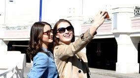 Girlfriends taking selfie on city background stock footage