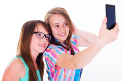 Girlfriends taking selfie with phone Royalty Free Stock Image