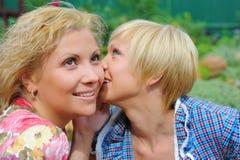 Girlfriends talking, gossips in secret Stock Photos
