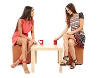 Girlfriends talking over a cup of tea Royalty Free Stock Photo