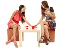 Girlfriends talking over a cup of tea Royalty Free Stock Photography