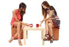 Girlfriends talking over a cup of tea Stock Photos