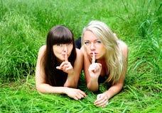 Girlfriends talking secret Stock Photography