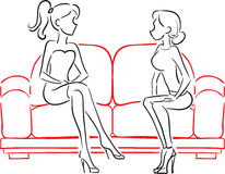 Girlfriends talking sitting on sofa Stock Photography