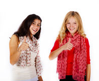 Girlfriends thumps up Stock Images