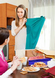 Girlfriends together looking new green dress Stock Photos
