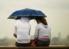 Girlfriends under a umbrella Royalty Free Stock Photo