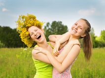 Girlfriends walk and play a meadow Royalty Free Stock Photography