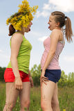 Girlfriends walk and play a meadow Stock Image