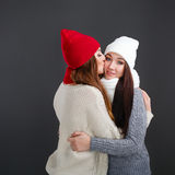 Girlfriends in a warm sweater. Kiss of love. Stock Photo