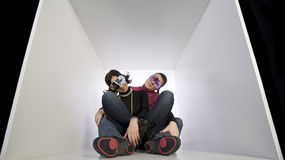 Girlfriends wearing disguise masks. Two women in white box wearing disguise on eyes. Best Friends together Stock Photos