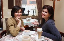 Girlfriends 40 years in a cafe Royalty Free Stock Images
