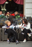 Girlfriens talking sitting in the outdoor coffee bar, Trieste Royalty Free Stock Photography